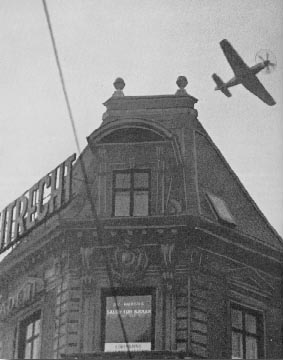 Mustang fighter flying low over Copenhagen during the attack