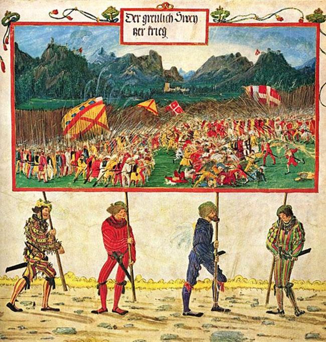 Albrecht Altdorfer; Triumphzug Kaiser Maximilians/ Szene; Der Schweizer Krieg, 1513-15 (Wikipedia). Lige så spraglet og farverigt klædt, som 14-1500-tallets lejesoldater, også kaldet landsknægte, var - lige brutale og rå var de overfor de civile, der befandt sig i krigszonen. Også i Danmark under Grevens fejde 1534-36 led borgerne i Aalborg og på Fyn voldsomt under deres plyndringer, afbrændinger, drab og voldtægter. Odense blev raseret hele tre gange under krigen. Men med deres stærke loyalitet (så længe de blev betalt!) og krigskyndighed var de uvurderlige for krigsførelsen.